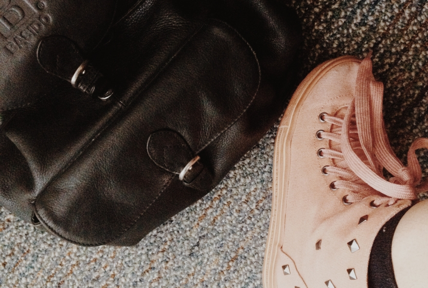studded pink sneakers and leather backpack bag